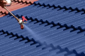 Photo of a roof being sprayed with a Shield Coat protective roof coating